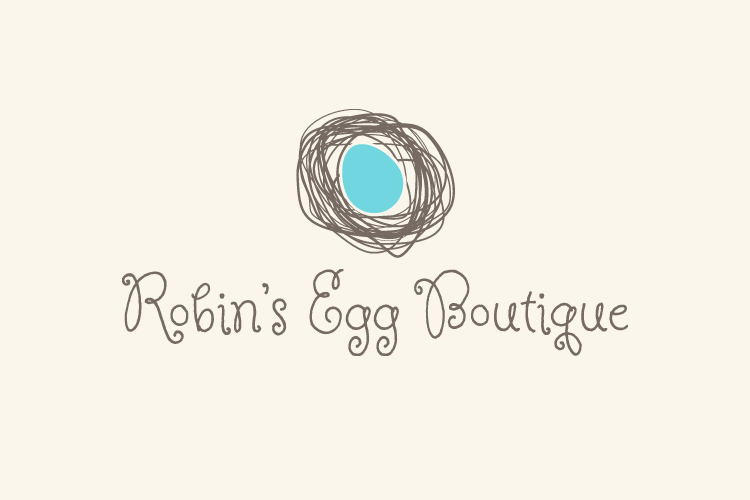 robin's egg boutique logo - blue egg in a nest